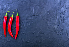 Red chili pepper on a dark background. Concept with space for your text Royalty Free Stock Photos
