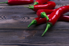 Red chili pepper on the dark wood background, close up Royalty Free Stock Image