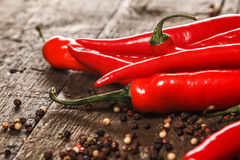 Red chili pepper and different types of grains Stock Photography