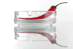 Red chili pepper in glass ash-tray Stock Image
