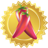 Red Chili Pepper with Gold Label. Pair of red chili peppers on a gold seal Royalty Free Stock Image
