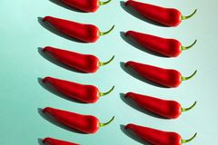 Red chili pepper on a green background isometric. stock photos