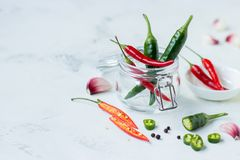 Red chili pepper, green jalapeno pepper and garlic.  stock photo