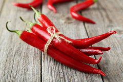 Red chili pepper on a grey wooden background Royalty Free Stock Images