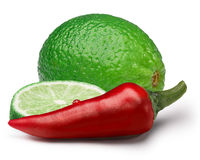 Red Chili pepper with lime, paths. Red chili pepper with lime slices. Ingredients for hot sauce. Clipping paths, shadows separated, infinite depth of field Stock Image
