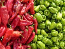 Red Chili Pepper Near Green Chili Pepper royalty free stock photography
