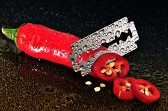 Red Chili Pepper Sliced by a Blade Stock Photography