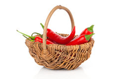 Red chili pepper in a wicker basket Stock Photo