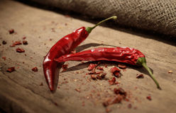 Red chili pepper on a woden table Stock Image