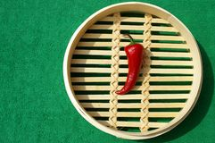 Red chili peppers. Two red chili peppers on bamboo Stock Photos