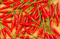 Red chili peppers. Bunch red chili peppers on wooden board Stock Images
