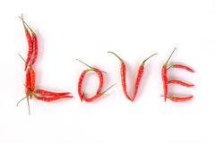 Red chili peppers in alphabet LOVE Royalty Free Stock Images