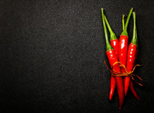 Red chili peppers on black background, Fresh hot chili peppers. Fresh spice ingredient for cooking Royalty Free Stock Photo