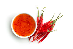 Red chili peppers and chili sauce. Red chili peppers and chili sauce isolated on white background Stock Photo