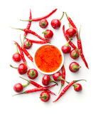 Red chili peppers and chili sauce. Royalty Free Stock Photo