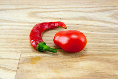 Red chili peppers on chopping board Royalty Free Stock Photo