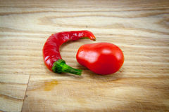 Red chili peppers on chopping board Stock Images