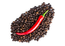 Red chili peppers and coffee beans Royalty Free Stock Photos