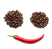 Red chili peppers and coffee beans Royalty Free Stock Photo