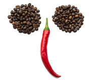 Red chili peppers and coffee beans Royalty Free Stock Images
