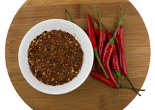 Red chili peppers and crushed chilli Stock Images