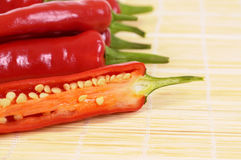 Red chili peppers cut half inside showing seeds closeup Royalty Free Stock Photos