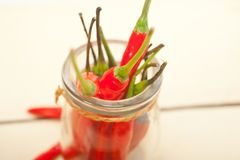 Red chili peppers on a glass jar Royalty Free Stock Photography