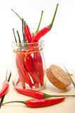 Red chili peppers on a glass jar Royalty Free Stock Photos