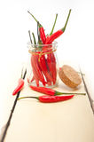 Red chili peppers on a glass jar Royalty Free Stock Images