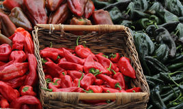 Red chili peppers. Red and green chili peppers in a basket at the Farmer's Market Royalty Free Stock Photo