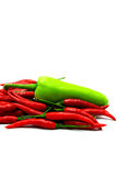 Red Chili Peppers and Green Pepper on White Backgr Royalty Free Stock Photo