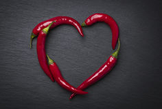 Red chili peppers heart for valentine's day. Stock Photos