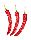 Red chili peppers, isolated on white Royalty Free Stock Photos