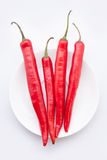 Red chili peppers. Isolated on the white background Stock Images