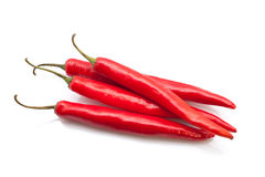 Red chili peppers. Isolated on the white background Royalty Free Stock Photos