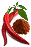 Red chili peppers with leaves and chili powder Royalty Free Stock Images