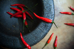 Red chili peppers in Mortar, Thai Kitchen Style Stock Photo
