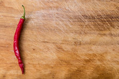 Red chili peppers over wood. Red hot chili peppers over wood royalty free stock photo