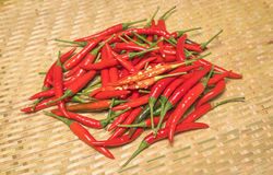 Red Chili Peppers With Seeds on bamboo mat. Closeup view and texture stock photo