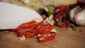 Red chili peppers slices over wooden cut by knife close up for mexican food stock video footage