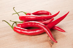 Red chili peppers on table Stock Photo