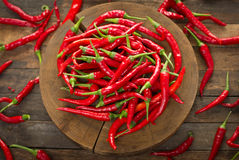 Red chili peppers on the table Stock Images