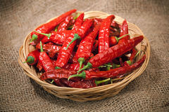 Red chili peppers on the wicker dish Royalty Free Stock Photos