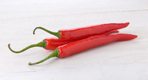 Red chili peppers on wood Royalty Free Stock Photo