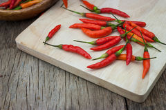 Red chili Peppers on wood chopping background Stock Image