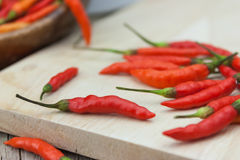 Red chili Peppers on wood chopping background Royalty Free Stock Photos