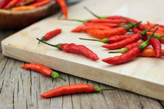 Red chili Peppers on wood chopping Stock Photography