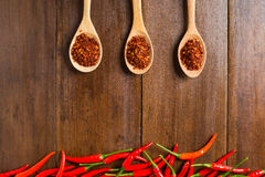 Red Chili peppers on wooden background Stock Photos