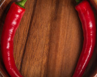 Red chili peppers in wooden bowl Stock Images
