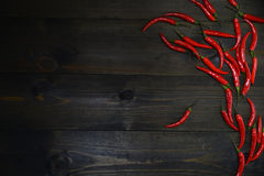 Red chili peppers on the wooden texture desk. Appetizer concept Royalty Free Stock Photos